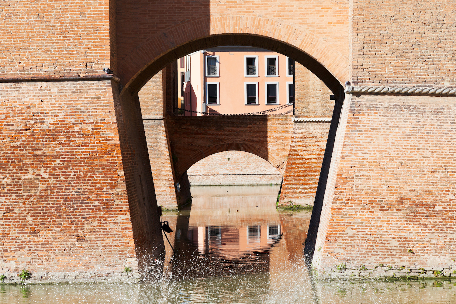 moat and bridges of Castle Estense in Ferrara, Italy